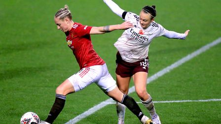 Manchester United's Leah Galton (left) and Arsenal's Caitlin Foord battle for the ball during the FA