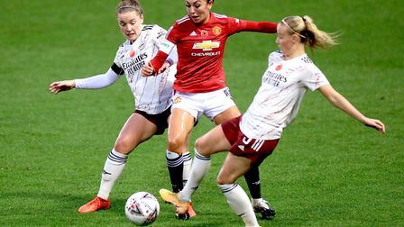 Manchester United's Katie Zelem (centre) battles for the ball with Arsenal's Kim Little (left) and B