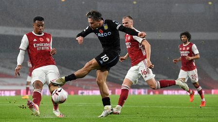 Aston Villa's Jack Grealish (centre) has a shot at goal during the Premier League match at the Emira