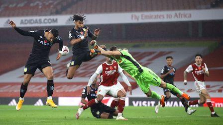 Arsenal goalkeeper Bernd Leno (centre) punches the ball clear during the Premier League match at the