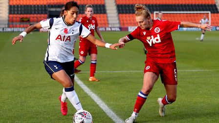 Tottenham Hotspur's Lucia Leon (left) and Reading's Molly Bartrip battle for the ball during the FA