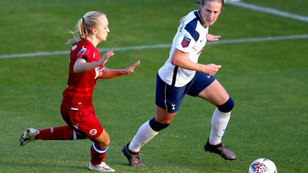 Reading's Amalie Eikeland (left) and Tottenham Hotspur's Kerys Harrop battle for the ball during the