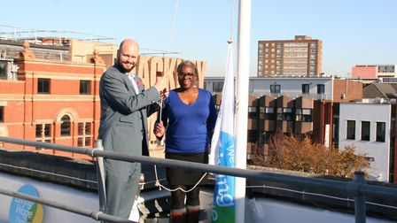 Mayor of Hackney with employment chief Cllr Carole Williams, raising a flag to commemorate the beggi
