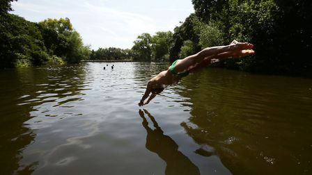 Diving into the Ponds in happier times. Picture: Yui Mok/PA
