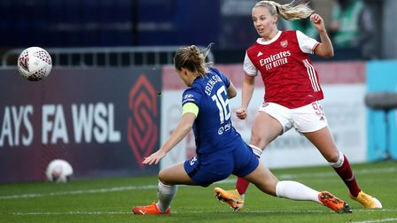 Arsenal's Beth Mead (right) attempts a shot on goal during the FA Women's Super League match at Mead