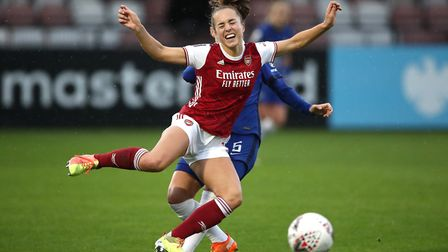 Arsenal's Lia Walti challenged by Cheslea's Sophie Ingle during the FA Women's Super League match at