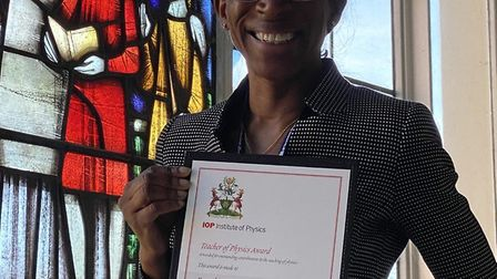 Esther McCall with her 2020 Teachers of Physics award. Picture: Esther McCall