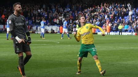 Angus Gunn of Norwich and James Maddison of Norwich celebrate victory at the end of the Sky Bet Cham
