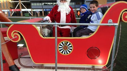Santa with some young Ipswich Town fans as the Round Table's Rudolph Run visited Portman Road last y