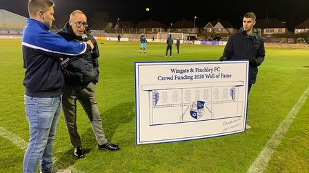 Wingate & Finchley chairman Aron Sharpe (centre) presenting the new wall of fame (Pic: Leo Style)