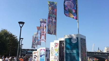 The finished artwork was showcased on flag banners and boards outside the Tate Modern in September.