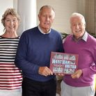 Alan Shubrook and wife Bridget with West Ham legend Sir Geoff Hurst (centre) and Alan's book. Pictur