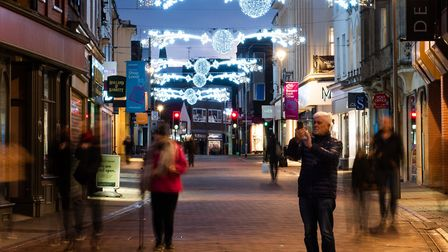 Evening walkers enjoying the Ipswich Christmas lights. Picture: SARAH LUCY BROWN