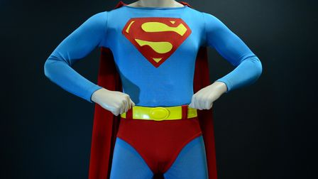 "The Superman costume that was worn by Christopher Reeve in ""Superman: The Movie."" on display at Prof"