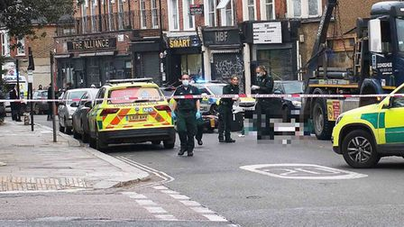 Police and paramedics on the scene of a crash in West Hampstead. Picture: Shademan Irvanipour