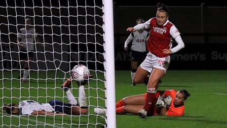 Arsenal's Caitlin Foord (right) scores her side's second goal of the game during the Continental Cup