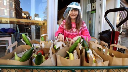 Helper Helen Spiby-Vann with a cart of parcels. Picture: Polly Hancock