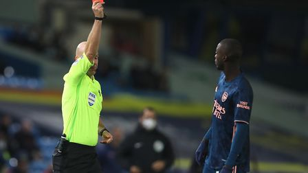 Arsenal's Nicolas Pepe is shown a red card by match referee Anthony Taylor