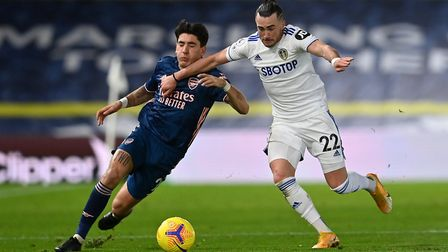 Arsenal's Hector Bellerin (left) and Leeds United's Jack Harrison battle for the ball