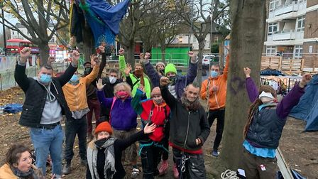 Climate activists celebrate at Dixon Clark Court after the High Court hearing on Wednesday. Picture: