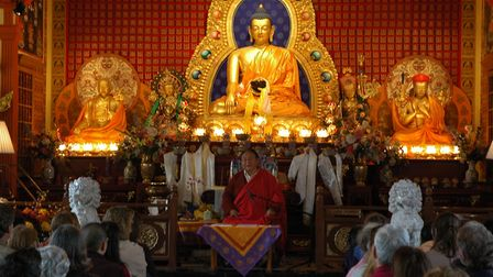 Sogyal Rinpoche teaching at the shrine of Lord Buddha, at the Sakya Monastery of Tibetan Buddhism in Seattle, in 2009.