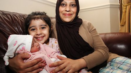 Mother Farrah Mian with her newborn baby and three-year-old daughter Fajr Ali.