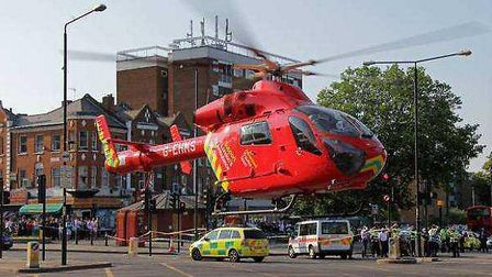 The air ambulance helicopter lands at the scene of the accident in Stamford Hill. Photo @ShulemStern