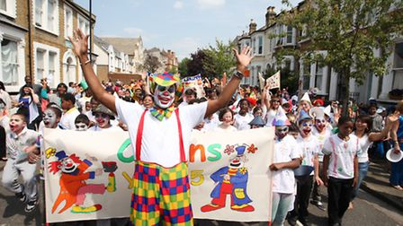 Children of Princess May Primary School, Stoke Newington, celebrate a circus day in the street.