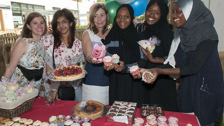 Supporters run the cake stall at the Swiss Cottage School and Development and Research Centre summer fete. Picture: Nigel...
