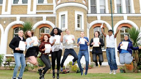 Puplis form St Angela's & St Bonaventure's Sixth Form jump for joy on A level results day.