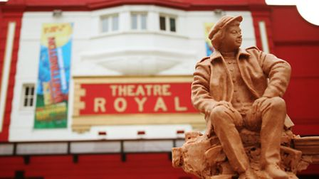 A model of a sculpture of theatre director Joan Littlewood is displayed outside Theatre Royal Stratford East.
