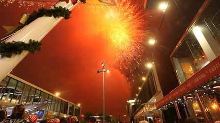 A firework display concludes the Santa's Arrival procession at Westfield Stratford City.