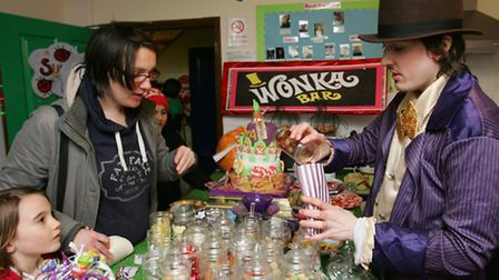 Willy Wonka dishes out sweets at the community party