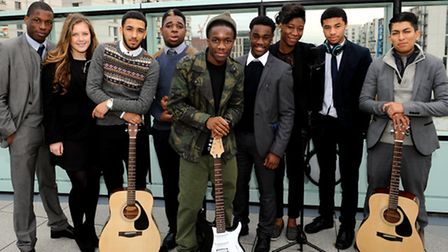 Tinchy Stryder (centre) with a group of year 12 performimg art students from Chobham Accademy