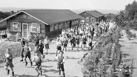 Children evacuated from East Ham in London, rush for lunch at Marchant's Hill School, Hindhead, Surrey, 1944