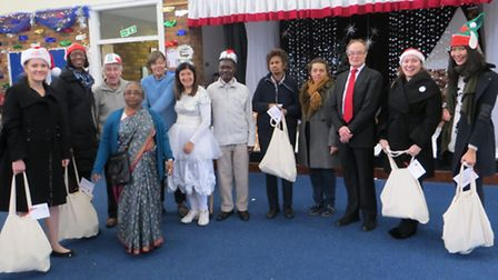 Cllr Neil Wilson, with employees from McGraw Hill Financial and beneficiaries of donations