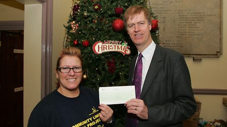 Stephen Timms donating for toy appeal. Paula Blake, with Stephen Timms