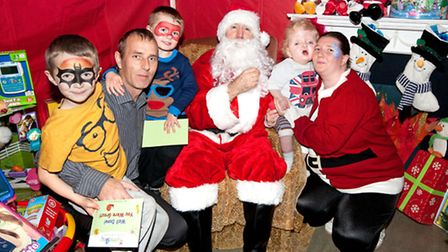Father Christmas with children at the Haven House Christmas Party. Image: The Photo People