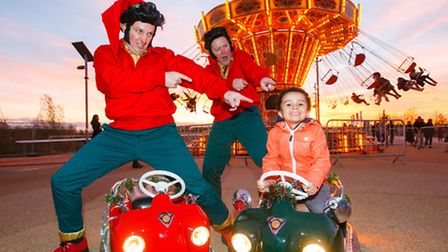 """""""Elvishes"""" - elves inspired by Elvis Presley - strike a pose with visitors to the fair"""