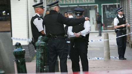 Police cordoned off the scene of the stabbing in Queens market