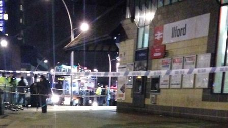 Police cordoned off Ilford station after a man, 17, was struck by a glass bottle in a fight between a group of men.