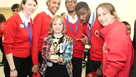Evelyn Shlomowitz, 10, with her trophy and City Year UK volunteers
