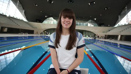Paralympic swimmer Amy Marren by the competition pool at the London Aquatics Centre