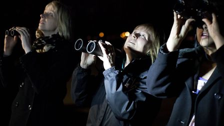 Nicky Brown, left, Lyndsay Jones, and Shaan Johal look at the stars in West Ham Park.