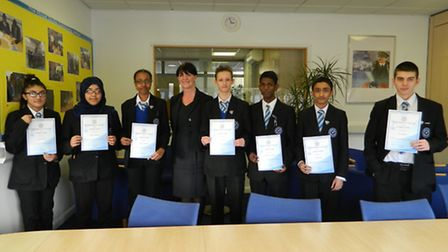 Some of the ten students who took their GCSE maths early pictured with head teacher Wendy Bower Picture: Royal Docks...