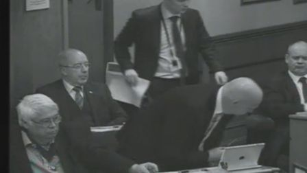 Cllr White makes his way to his seat.