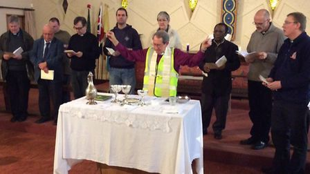 Bishop David Hawkins celebrating Holy Communion with representatives of churches in Newham