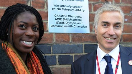 Christine Ohuruogu with head teacher Robert Clearly by a plaque that was unveiled today.