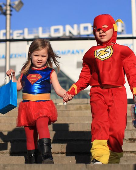 Amelia Brown and her brother Alfie dress up as Supergirl and The Flash