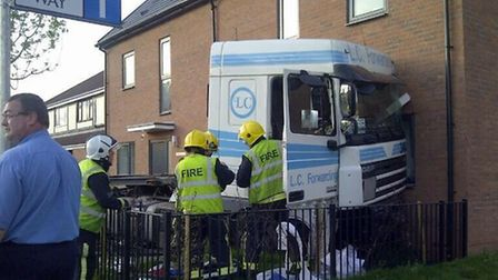 The lorry crashed through a metal fence and into a semi-detached house. Picture: Jack Betson